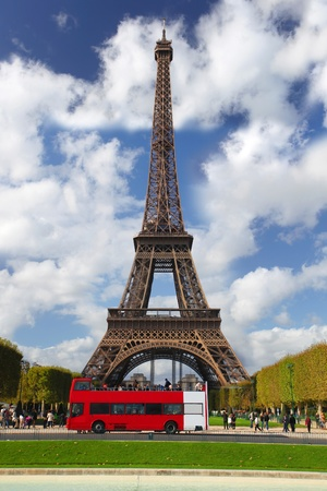 Paris, Eiffel tower with red bus in France photo