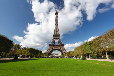 Eiffel tower with city park in Paris, France photo