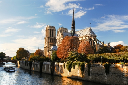 seine: Notre Dame with boat on Seine in Paris, France