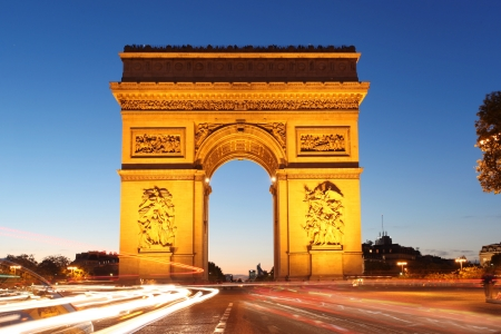 Famous Arc de Triomphe in the evening, Paris, France photo