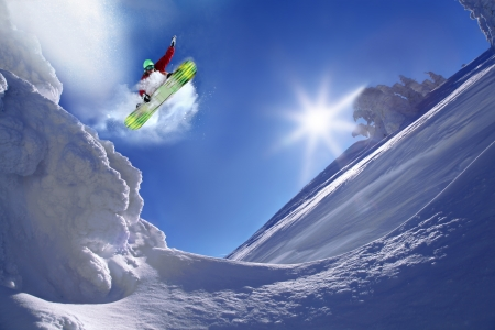 Snowboarder jumping against blue sky (sports, snowboard,\ jump)