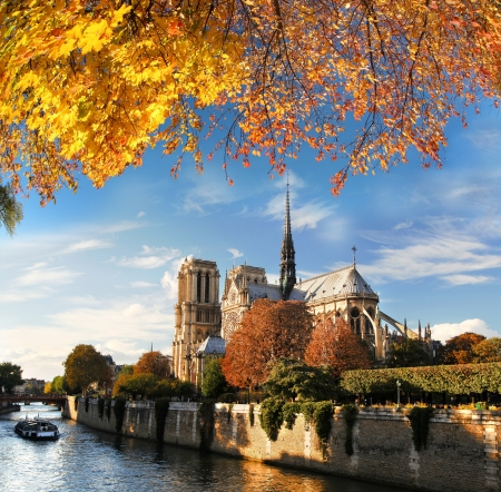 notre: Notre Dame with boat on Seine in Paris, France