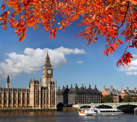autumn in the city: Big Ben with autumn leaves in London, England Stock Photo