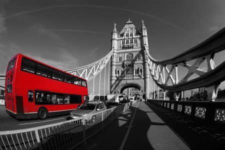 Famous Tower Bridge with red bus  in London, England photo