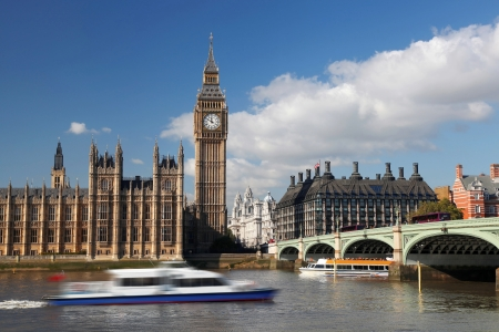 Big Ben with motor boat in London, England