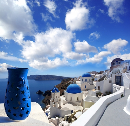 Santorini island with church and blue vase in Greece photo