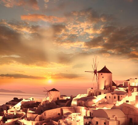 Windmills against colorful sunset, Santorini, Greece Stock Photo - 16937703