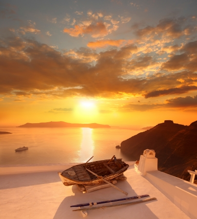 Santorini with old Vase and boat on white roof in Fira, Greece photo