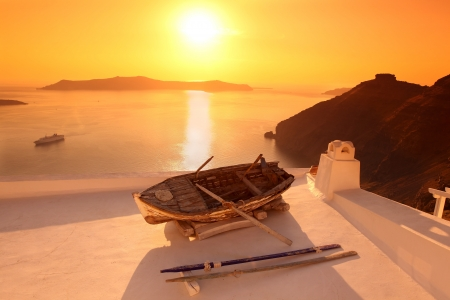 fira: Santorini with old Vase and boat on white roof in Fira, Greece Stock Photo