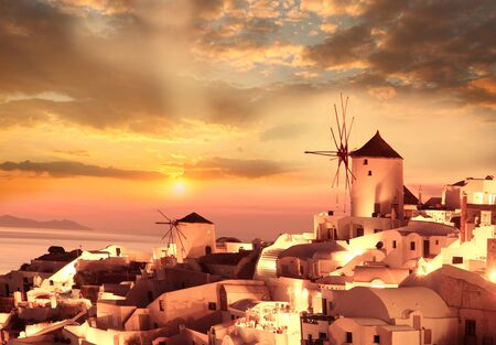 Windmill against colorful sunset, Santorini, Greece Stock Photo - 17559853