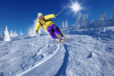 ski lift: Skier skiing downhill in high mountains