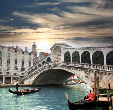 Venice,  Rialto bridge and with gondola on Grand Canal, Italy photo