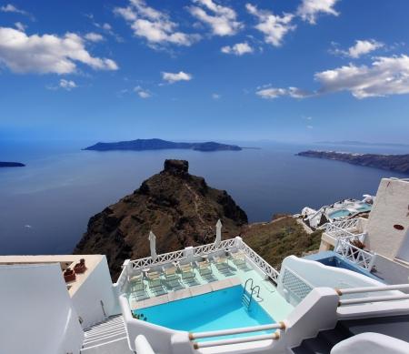 aegean sea: Luxury resort swimming pool in Santorini, Greece Stock Photo