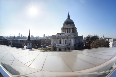 St Paul Cathedral in London  against modern buildings photo