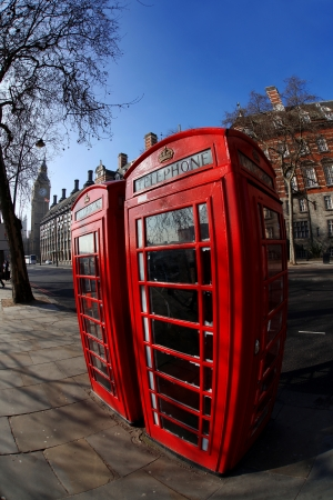 Red phone boxes against Big Ben in London, UK photo