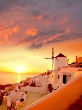 Windmill against colorful sunset, Santorini, Greece photo