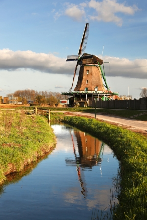 Traditional Dutch windmills with canal close the Amsterdam, Holland Stock Photo - 19548714