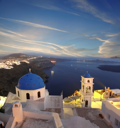 Famous Santorini in the evening with churches, Greece photo