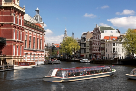 Amsterdam city with boat on canal in Holland photo