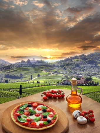 Italian pizza in Chianti, famous vineyard landscape in Italy photo