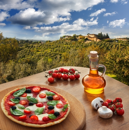 Italian pizza in Chianti, famous vineyard landscape in Italy