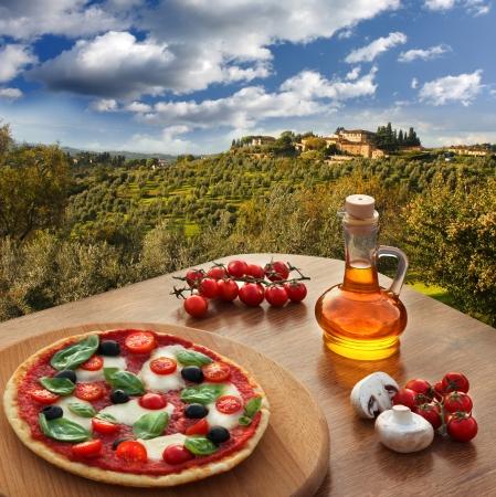 siena italy: Italian pizza in Chianti, famous vineyard landscape in Italy