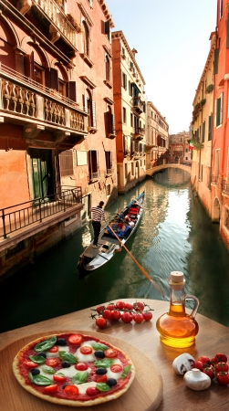 Classic Italian pizza in Venice against canal, Italy
