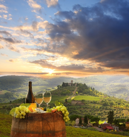 tuscany: White wine with barrel on vineyard in Chianti, Tuscany, Italy