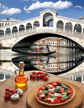 Classic Italian pizza in Venice against canal, Italy photo
