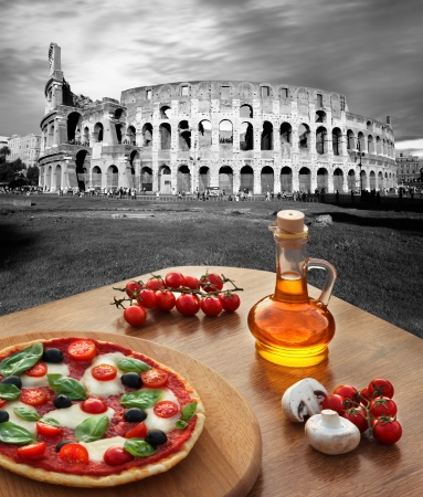 dinning table: Colosseum in Rome with traditional pizza in Italy