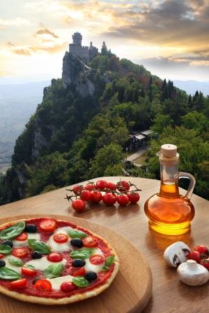 San Marino Castle, Rocca della Guaita with Italian pizza in Italy