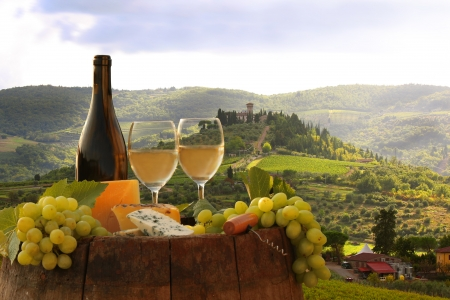 siena italy: White wine with barrel on vineyard in Chianti, Tuscany, Italy
