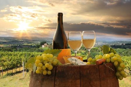 chianti: White wine with barrel on vineyard in Chianti, Tuscany, Italy