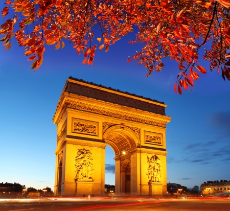 Famous Arc de Triomphe in autumn, Paris, France photo