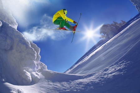 Skier during extreme jump from the rock photo