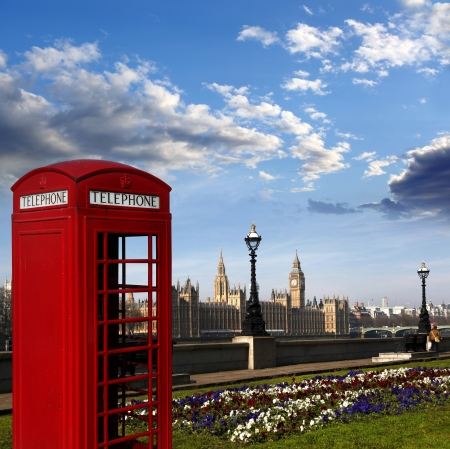 english famous: Famous English red telephone box with Big Ben in London, UK Stock Photo