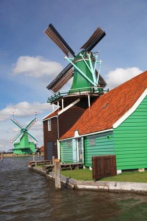Traditional Dutch windmills in Zaanse Schans,  Amsterdam, Holland photo