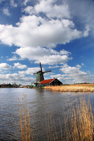 Traditional Dutch windmills in Zaanse Schans,  Amsterdam, Holland photo