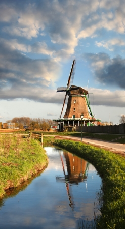 Traditional Dutch windmill in Zaanse Schans,  Amsterdam, Holland photo