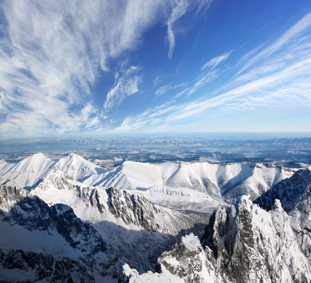Winter landscape with snow covered high mountains photo