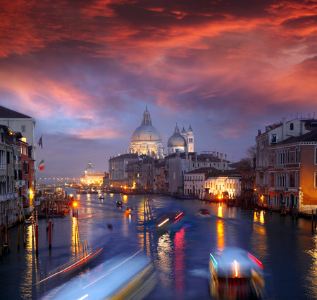 Grand Canal and Basilica Santa Maria della Salute during amazing evening in Italy photo