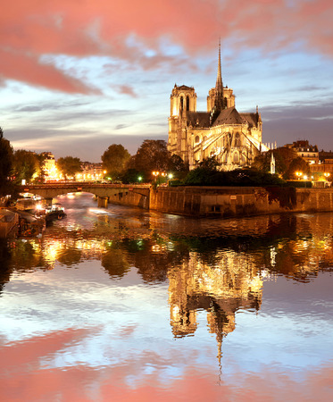 dame: Notre Dame cathedral against sunset in Paris, France