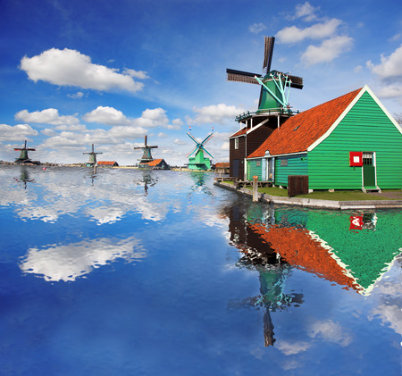 dutch landmark: Traditional Dutch windmills with canal close the Amsterdam, Holland Stock Photo