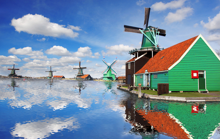 Traditional Dutch windmills with canal close the Amsterdam, Holland photo