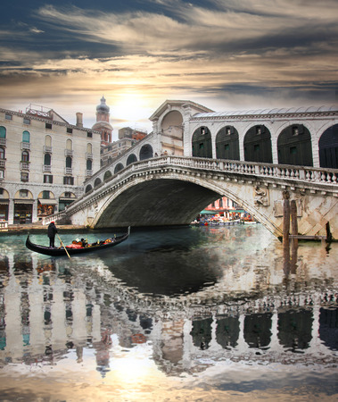 rialto bridge: Venice, Rialto bridge and with gondola on Grand Canal, Italy