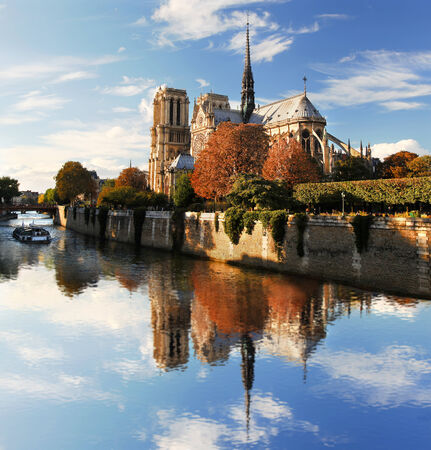 Notre Dame with boat on Seine in Paris, France photo
