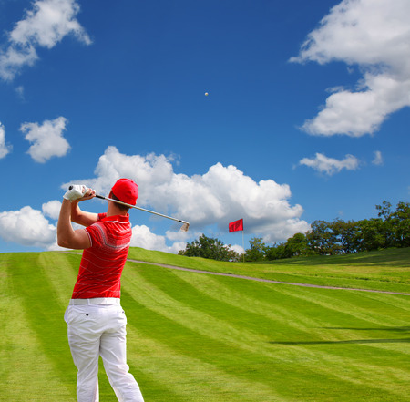 Man playing golf against blue sky photo
