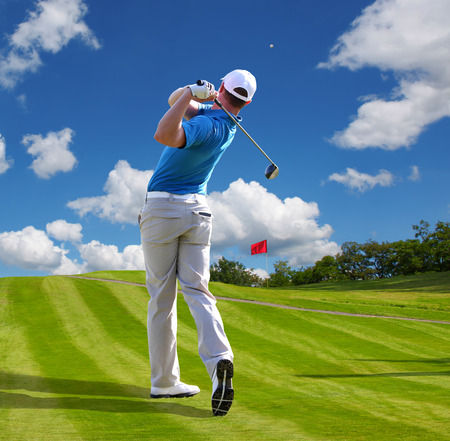 golf swing: Man playing golf against blue sky