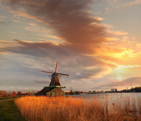 Traditional Dutch windmills with canal near the Amsterdam, Holland photo
