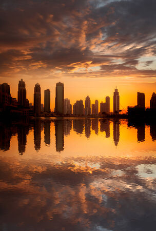east coast: Dubai with golden silhouette of downtown against lagoon in United Arab Emirates Stock Photo